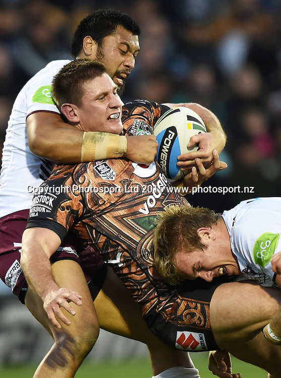 Jacob Lillyman is tackled during the NRL Rugby League match between the Vodafone Warriors and The Manly Sea Eagles at Mt Smart Stadium, Auckland, New Zealand. Saturday 25 July 2015. Copyright Photo: Andrew Cornaga / www.Photosport.nz