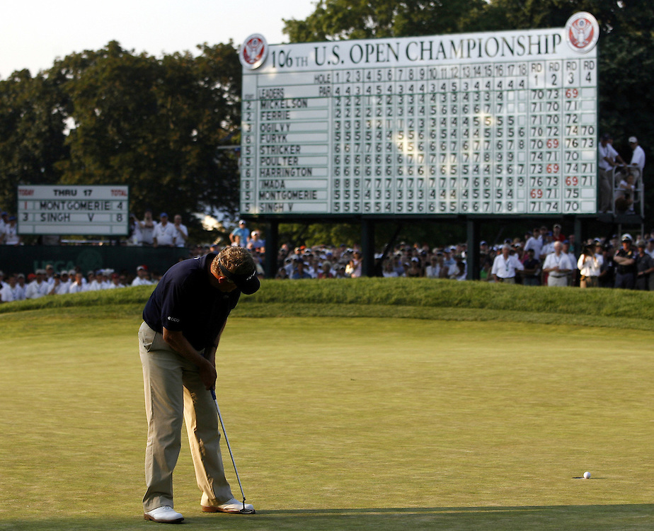 Colin Montgomerie of Scotland barely misses his bogey putt on the eighteenth as it rims the cup during the final day of the US Open Golf Championship at Winged Foot Golf Club in Mamaroneck, New York Sunday, 18 June 2006. Had the putt dropped, Montgomerie would have played an 18-hole playoff against eventual winner Geoff Oglivy of Australia..