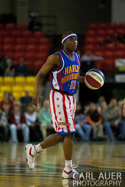 05 May 2006: Keiron 'Sweet P' Shine dribbles the ball up court in the Harlem Globetrotters basketball game vs the New York Nationals at the Sulivan Arena in Anchorage Alaska during their 80th Anniversary World Tour.