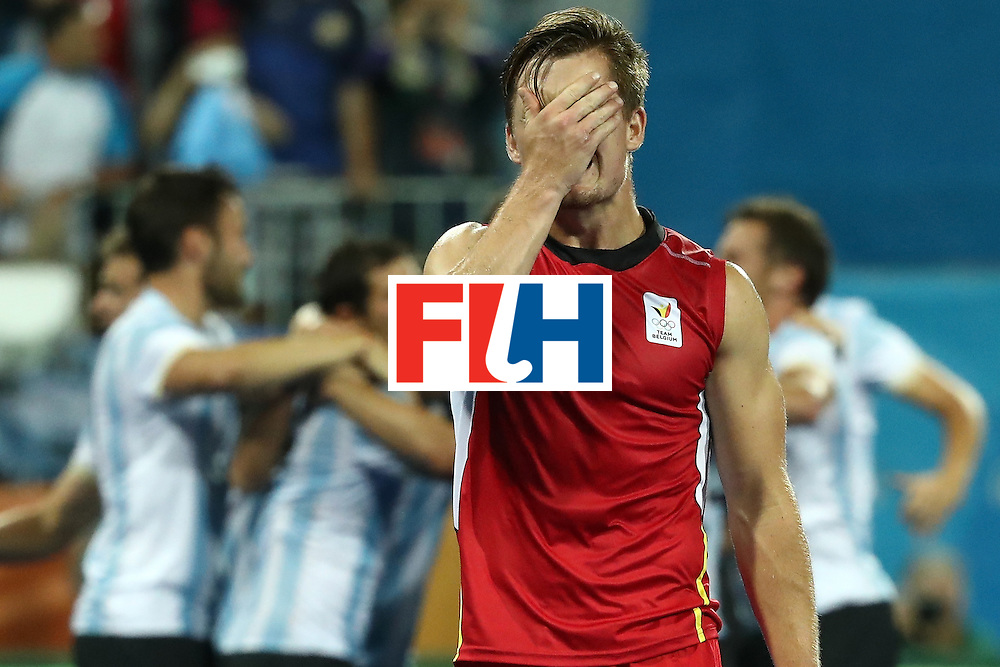 RIO DE JANEIRO, BRAZIL - AUGUST 18:  Tom Boon #27 of Belgium shows his emotion after losing the Men's Hockey Gold Medal match between Belgium and Argentina on Day 13 of the Rio 2016 Olympic Games at Olympic Hockey Centre on August 18, 2016 in Rio de Janeiro, Brazil.  (Photo by Sean M. Haffey/Getty Images)