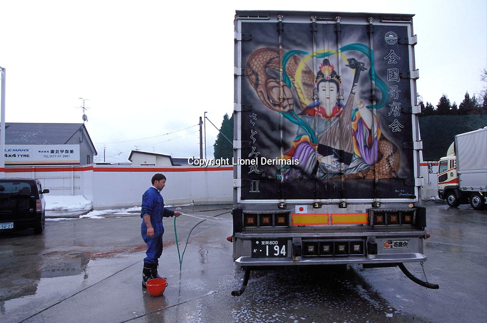 Nobuyuki washes his truck just a few hours after leaving Tokyo en route for Sapporo.