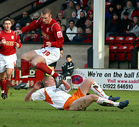 Photo: Dave Linney.<br />Walsall v Blackpool. Coca Cola League 1. 31/12/2005.<br />James Constable(Walsall) leaps out of the way as   Keith Southern (Blackpool) slides in.