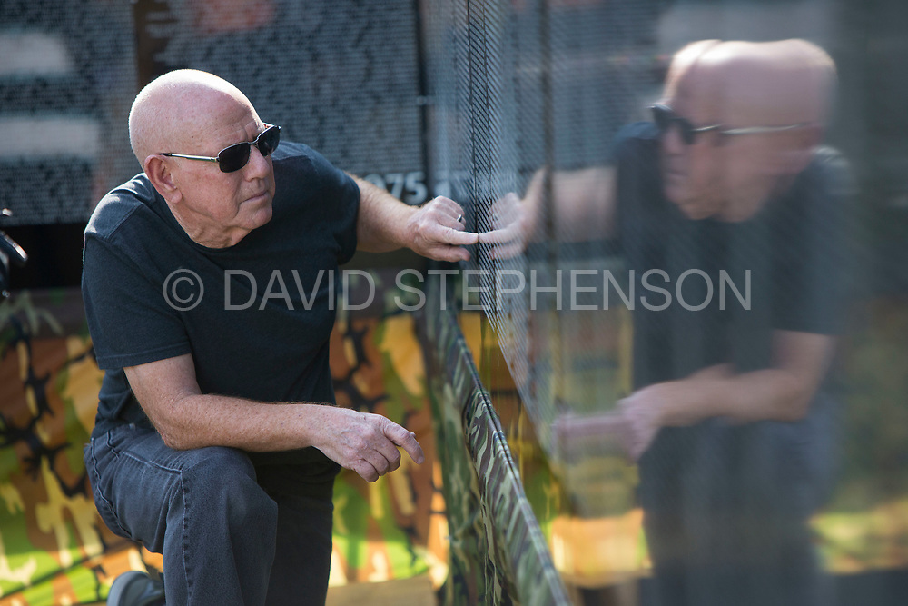 Carl Hoskins, who served in Vietnam, looks for the name of a school friend inscribed on The Vietnam Veterans Moving Wall during the closing ceremonies of the tribute at the UAW Local 863 Union Headquarters in Cincinnati, Oh, on 8/27/17. Photo by David Stephenson