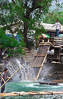 Bamboo rafts are being unloaded after being carted from a different section of the Dragon River near Yangshuo.