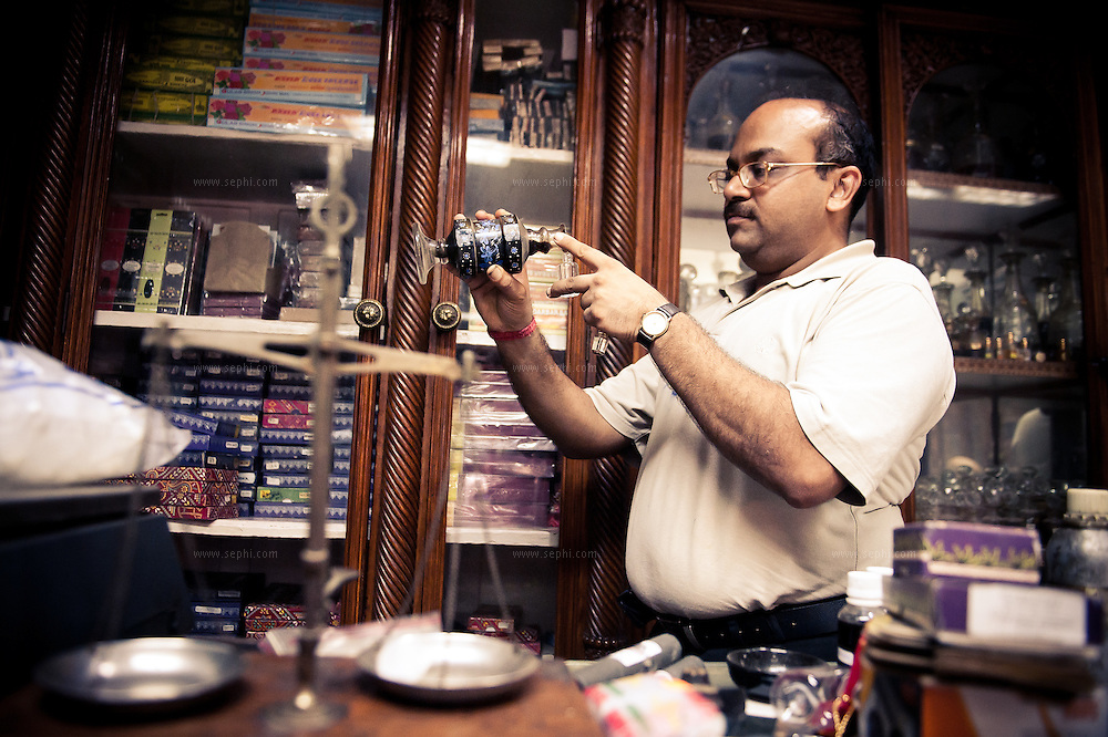Mukul Gundhi pouring aftar into a small container at Gulabsingh Johrimal, one of the most famous Attar sellers in India, dating back to 1818. Attar is a natural perfume, made using a sandalwood oil base mixed with distilled fresh-flower essences such as rose, lavender and basil. (gulabsinghjohrimal.com, 320 Dariba Kalan, Chandni Chowk, Ph: (011) 2326 3743)