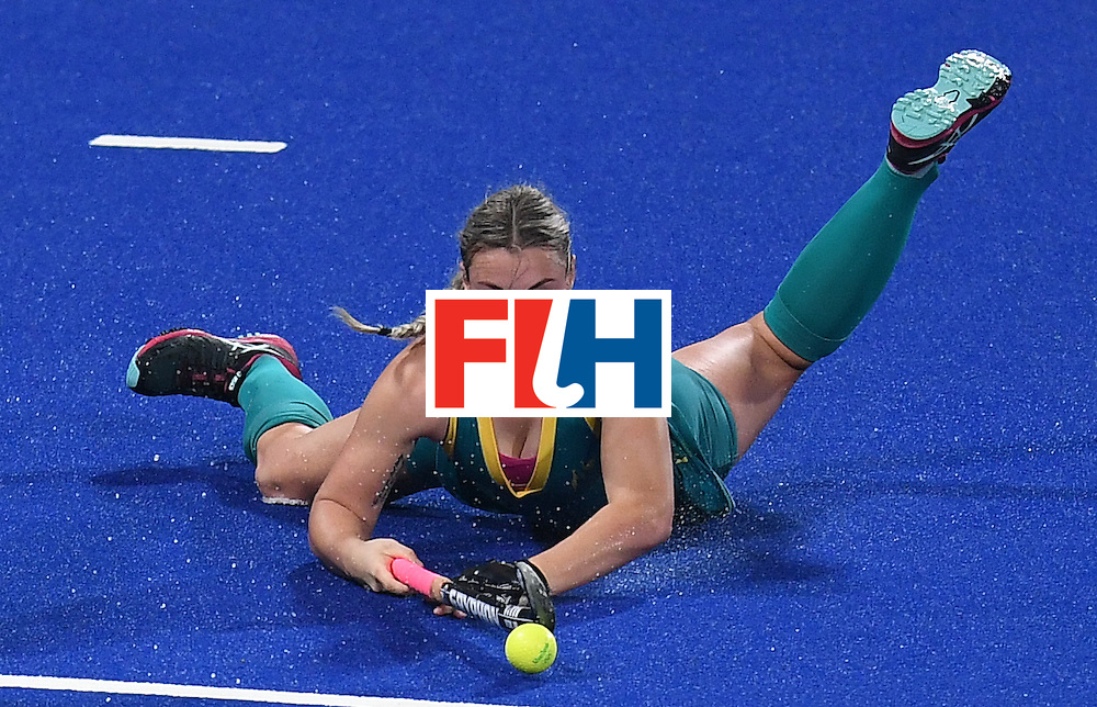 Australia's Mariah Williams looks on after stopping the ball during the women's field hockey Britain vs Australia match of the Rio 2016 Olympics Games at the Olympic Hockey Centre in Rio de Janeiro on August, 6 2016. / AFP / MANAN VATSYAYANA        (Photo credit should read MANAN VATSYAYANA/AFP/Getty Images)