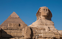 The Sphinx and pyramid against a deep blue sky in Giza, Egypt.
