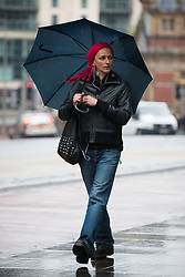 © Licensed to London News Pictures. 14/05/2015. Bristol, UK. A woman braving the wet weather in Bristol city centre today, Thursday 14th May 2015. Photo credit : Rob Arnold/LNP
