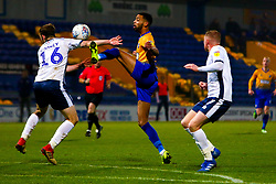 Ryan Cooney of Bury sticks out an arm to block a pass to CJ Hamilton of Mansfield Town - Mandatory by-line: Ryan Crockett/JMP - 04/12/2018 - FOOTBALL - One Call Stadium - Mansfield, England - Mansfield Town v Bury - Checkatrade Trophy