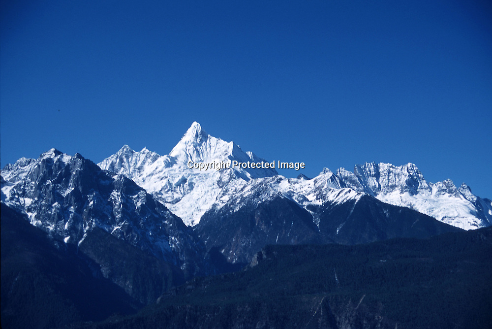"MEILI MOUNTAIN, DECEMBER 17, 2000:  a view of Mt. Meili in deqin county, Yunnan province , December 17, 2000..Mt. Meili is the highest peak in Yunnan province and according to supporters from Deqin county, it's a ""proof"" that the 'real"" Shangri-La is located in deqin county. The fictuous Mt. Karakal which is described in James Hilton's Lost Horizon, alledgedly is modelled on Mt. Meili in Yunnan province.."