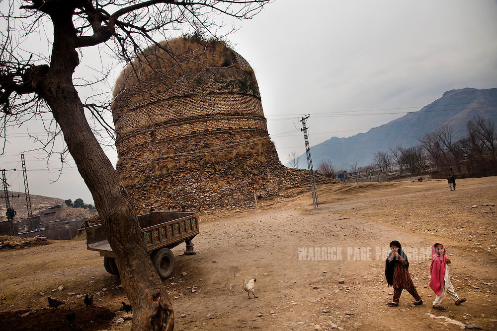 Village children play next to the Shingardar Stupa in the Swat Valley, on February 11, 2011, outside Mingora, Pakistan. The Kingdom of Gandhara lasted from early 1st millennium BC to the 11th century AD, and was located in northern Pakistan and eastern Afghanistan.   (Photo by Warrick Page)