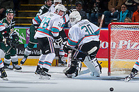 KELOWNA, CANADA - JANUARY 08: Joe Gatenby #28 and Michael Herringer #30 of Kelowna Rockets watch the puck after a pass by the Everett Silvertips on January 2, 2016 at Prospera Place in Kelowna, British Columbia, Canada.  (Photo by Marissa Baecker/Shoot the Breeze)  *** Local Caption *** Joe Gatenby; Michael Herringer;