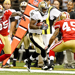 August 12, 2011; New Orleans, LA, USA; New Orleans Saints wide receiver Joe Morgan (13) runs from San Francisco 49ers cornerback Phillip Adams (35) and defensive back Anthony West (45) during the second half of a preseason game at the Louisiana Superdome. The New Orleans Saints defeated the San Francisco 49ers Mandatory Credit: Derick E. Hingle