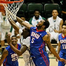 Jan 17, 2016; New Orleans, LA, USA; Southern Methodist Mustangs forward Markus Kennedy (5) blocks a shot by Tulane Green Wave forward Jernard Jarreau (22) during the second half of a game at the Devlin Fieldhouse. Southern Methodist defeated Tulane 60-45. Mandatory Credit: Derick E. Hingle-USA TODAY Sports