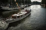 A beautiful boat on an evening cruise on the Waalseilandgracht.