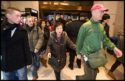 Shoppers rush through the doors of  Harrods as the Harrods Christmas Sale opens, Tuesday December 27, 2011. Photo By Andrew Parsons/i-Images