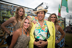 © Licensed to London News Pictures . 09/08/2015 . Siddington , UK . KID CREOLE AND THE COCONUTS backstage . The Rewind Festival of 1980s music , fashion and culture at Capesthorne Hall in Macclesfield . Photo credit: Joel Goodman/LNP