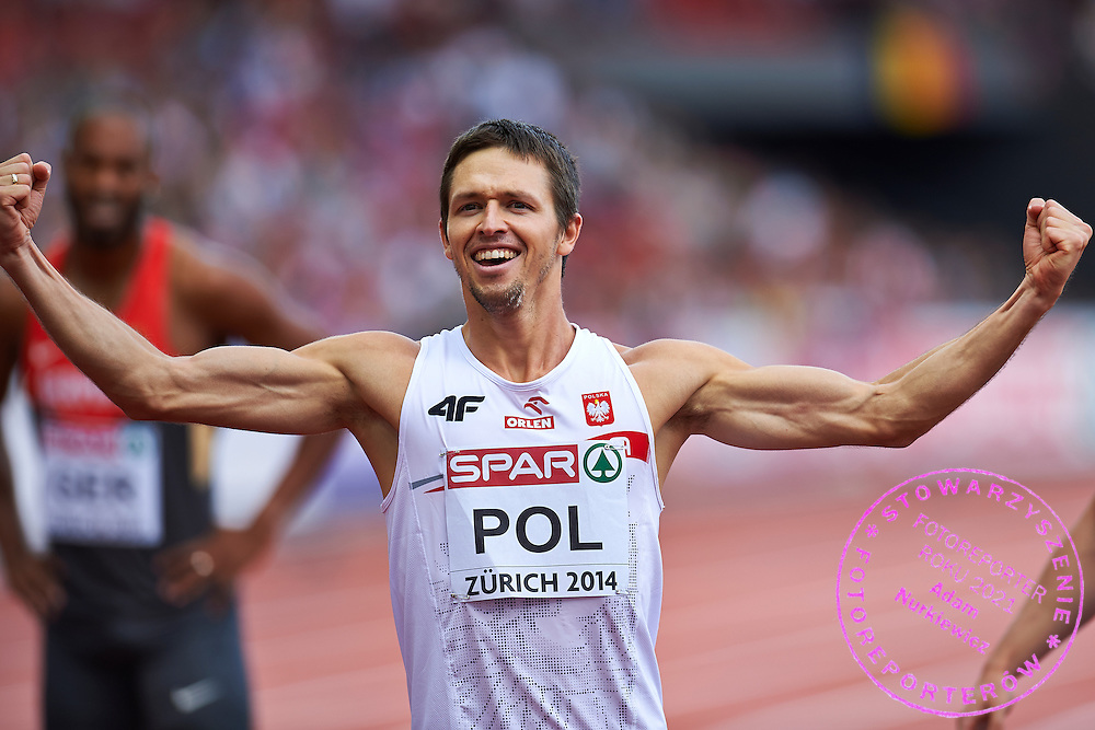 Kacper Kozlowski from Poland celebrates bronze medal in Men's Relay 4 x 400 meters final during the Sixth Day of the European Athletics Championships Zurich 2014 at Letzigrund Stadium in Zurich, Switzerland.<br /> <br /> Switzerland, Zurich, August 17, 2014<br /> <br /> Picture also available in RAW (NEF) or TIFF format on special request.<br /> <br /> For editorial use only. Any commercial or promotional use requires permission.<br /> <br /> Photo by &copy; Adam Nurkiewicz / Mediasport