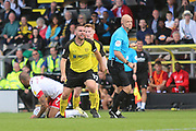 Burton Albion defender Jake Buxton (5) is annoyed with referee Nicholas Kinseley after Rotherham United defender Richard Wood (6) tackles Burton Albion midfielder Scott Fraser (8) but no penalty is awarded during the EFL Sky Bet League 1 match between Burton Albion and Rotherham United at the Pirelli Stadium, Burton upon Trent, England on 17 August 2019.