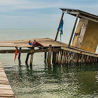Garifuna fishing on the pier.  (Caye Caulker, Belize)