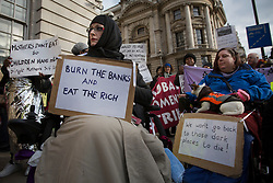 © licensed to London News Pictures. London, UK 16/02/2013. People protesting against the high energy and fuel prices dictated by the six big energy companies in the UK, outside Department of Energy and Climate Change in Whitehall, London. Photo credit: Tolga Akmen/LNP