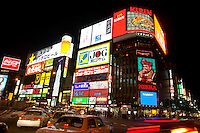 The bright neon signs light up the darkness of Sapporo city's entertainment quarter, known as Susukino. Hokkaido, Japan.