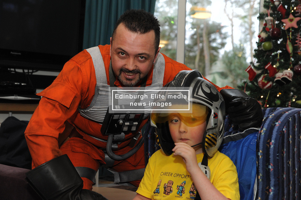 Star Wars, Rachel House, Kinross, 11-12-2016<br /> <br /> People dressed as Star Wars characters to visit children's hospice. Edinburgh 's Capital Sci-Fi Con organiser Keith Armour and other delegates to don costumes and visit children and their families at Rachel House.<br /> <br /> Rebel with 8 year old McKenzie<br /> <br /> (c) David Wardle | Edinburgh Elite media