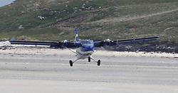Barra Airport is a short-runway airport situated in the wide shallow bay of Traigh Mhòr at the north tip of the island of Barra in the Outer Hebrides, Scotland. Barra is now the only beach airport anywhere in the world to be used for scheduled airline services. Loganair Twin Otter landing. (c) Stephen Lawson | Edinburgh Elite media