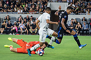 LAFC goalkeeper Tyler Miller (1) and defender Eddie Segura (4) block a kick by San Jose Earthquakes forward Danny Hoesen (9) during an MLS soccer match, Wednesday, Aug. 21, 2019, in Los Angeles. (Ed Ruvalcaba/Image of Sport)