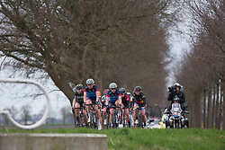 The front group approaches a bridge and a corner in the third lap of Stage 3 of the Healthy Ageing Tour - a 154.4 km road race, between  Musselkanaal and Stadskanaal on April 7, 2017, in Groeningen, Netherlands.