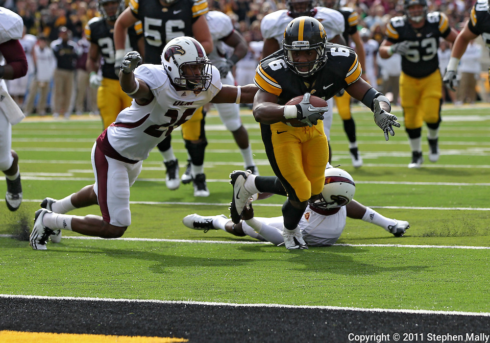 September 24, 2011: Iowa Hawkeyes wide receiver Keenan Davis (6) tries to pull away from Louisiana Monroe Warhawks cornerback Vincent Eddie (27) towards the end zone as Louisiana Monroe Warhawks safety Isaiah Newsome (25) closes in during the first quarter of the game between the Iowa Hawkeyes and the Louisiana Monroe Warhawks at Kinnick Stadium in Iowa City, Iowa on Saturday, September 24, 2011. Iowa defeated Louisiana Monroe 45-17.