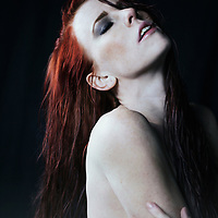 redheaded woman with wet hair taking a deep breath
