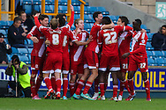 Middlesbrough players celebrate scoring their second goal against Millwall to make it 0-2 during the Sky Bet Championship match at The Den, London<br /> Picture by David Horn/Focus Images Ltd +44 7545 970036<br /> 06/12/2014