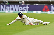 Dom Bess of England slides to collect the ball during second day of the Specsavers International Test Match 2018 match between England and India at Edgbaston, Birmingham, United Kingdom on 2 August 2018. Picture by Graham Hunt.