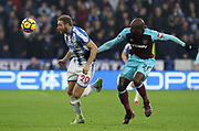 Huddersfield Town's Laurent Depoitre shields the ball from Angelo Ogbonna of West Ham United during the Premier League match between Huddersfield Town and West Ham United at the John Smiths Stadium, Huddersfield, England on 13 January 2018. Photo by Paul Thompson.