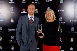 CARDIFF, WALES - Monday, October 2, 2017: FAW Player of the Year Chris Gunter with his award with Vauxhall's Cheryl Stibbs during the FAW Awards Dinner at the Hensol Castle. (Pic by David Rawcliffe/Propaganda)