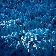 The Knik Glacier in Alaska. Lack of snow-cover expose the ash fallout from the nearby Redoubt Volcano, reducing the albedo effect. There are thousands of glaciers in Alaska, and at least 616 of them are named. Together, they are losing 75 billion tons of ice each year due to melting. That figure is likely to increase in future years. May 2015 was the hottest in 91 years.