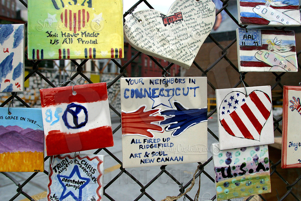 Aug 16, 2002; New York, NY, USA; Visitors from all around the country painted color tiles and dontated them to hang outside on the fence across the street from St. Vincents Hospital in Midtown Manhattan.  Mandatory Credit: Photo by Shelly Castellano/ZUMA Press. (©) Copyright 2002 by Shelly Castellano