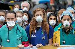 © Licensed to London News Pictures. 12/10/2019. London, UK. Extinction Rebellion Doctors Health March for the Planet takes place in central London with health workers wearing face masks highlighting the 180 deaths a week in the capital from pollution. XR activists calling on the government to act now on climate change have been protesting in central London for six days. Photo credit: Peter Macdiarmid/LNP