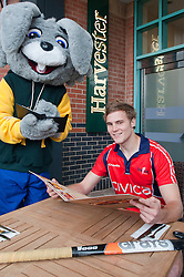 Official opening of Sheffield's new Harvester Salad & Grill at Meadowhall..Harvesters mascot  Harvey The Rabbit takes an order from  England A team and Sheffield Hockey club player Martin Ebbage. .10 November 2011. Image © Paul David Drabble