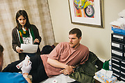 "BIRMINGHAM, AL – FEBRUARY 1, 2019:  Accompanied by his girlfriend Noel Morse (left), Warren ""Azad"" Stoddard (right), 24, receives medical treatment for a gunshot wound he suffered while fighting ISIS alongside Kurdish YPG forces in Syria. CREDIT: Bob Miller for The New York Times<br /> <br /> In the war against ISIS, American volunteers have joined the ranks of a Syrian militia, operating independently of the United States. Until recently, the predominantly Kurdish YPG forces had enjoyed air and ground support from the United States, but now that US is officially leaving, the remaining American volunteers face uncertain odds. <br /> <br /> Warren Stoddard, 24, comes from a long line of military veterans and active service members. So when a knee injury prevented him from enlisting in the Marines in 2016, he reached out to a YPG liaison on Facebook to declare his interest in volunteering. ""I always wanted to serve, to do something worthwhile and to take part in some historical event,"" Stoddard said. ""And I cared about the Kurdish cause."" Two years later, as the Turkish invasion placed added pressure on the predominantly Kurdish YPG, Stoddard finally received an invitation to join and purchased his own one way ticket. Six months later, while engaging an ISIS stronghold alongside his YPG unit, Stoddard caught bullet fragments in his his upper thigh and foot, where a small fragment is still lodged."