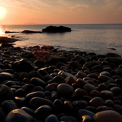 Early morning on the cobblestone beach in Momument Cove in Maine's Acadia National Park.