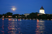 Full moon shines on Wascana Lake, Saskatchewan Legislature dome in background