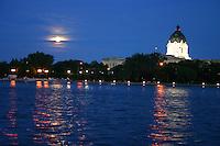 Full moon shines on Wascana Lake, Saskatchewan Legislature dome in background