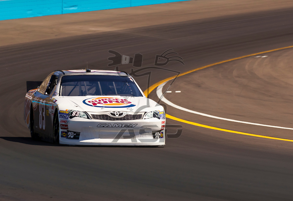 AVONDALE, AZ - MAR 03, 2012:  Landon Cassill (83) brings his NASCAR Sprint Cup car through turn 4 during qualifying for the Subway Fresh Fit 500 race at the Phoenix International Raceway in Avondale, AZ.