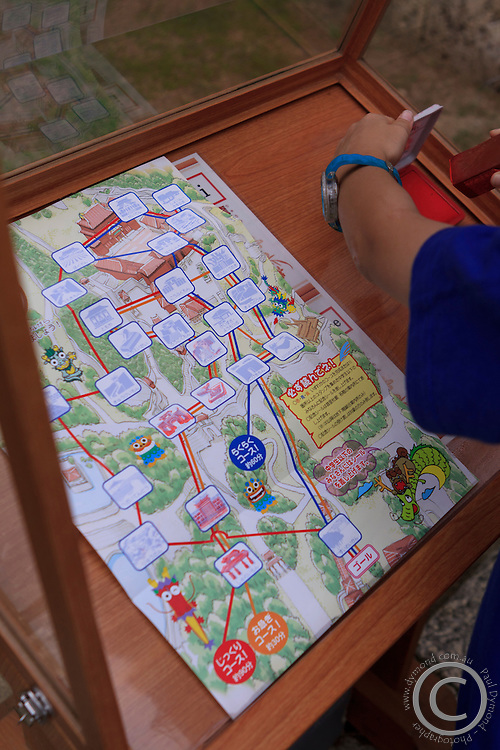 Collecting stamps makes a trip to Shuri Castle an interactive experience for children. Naha, Okinawa, Japan.