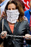 Roma 24 Giugno 2015<br /> Gli insegnanti protestano contro le riforme della scuola di Renzi, vicino  al Senato, dove giovedi il Governo Renzi ha deciso di votare la fiducia alla legge. Manifestante imbavagliata e incatenata.<br /> Rome June 24, 2015<br /> The teachers are protesting against Renzi's school reforms, , close to the Senate, where the government Renzi, thursday decided to vote confidence to the law. <br /> Protester gagged and chained