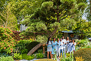 Revelation Avenue, a Gospel Choir on The Morgan Stanley Garden - Press preview day at The RHS Chelsea Flower Show.