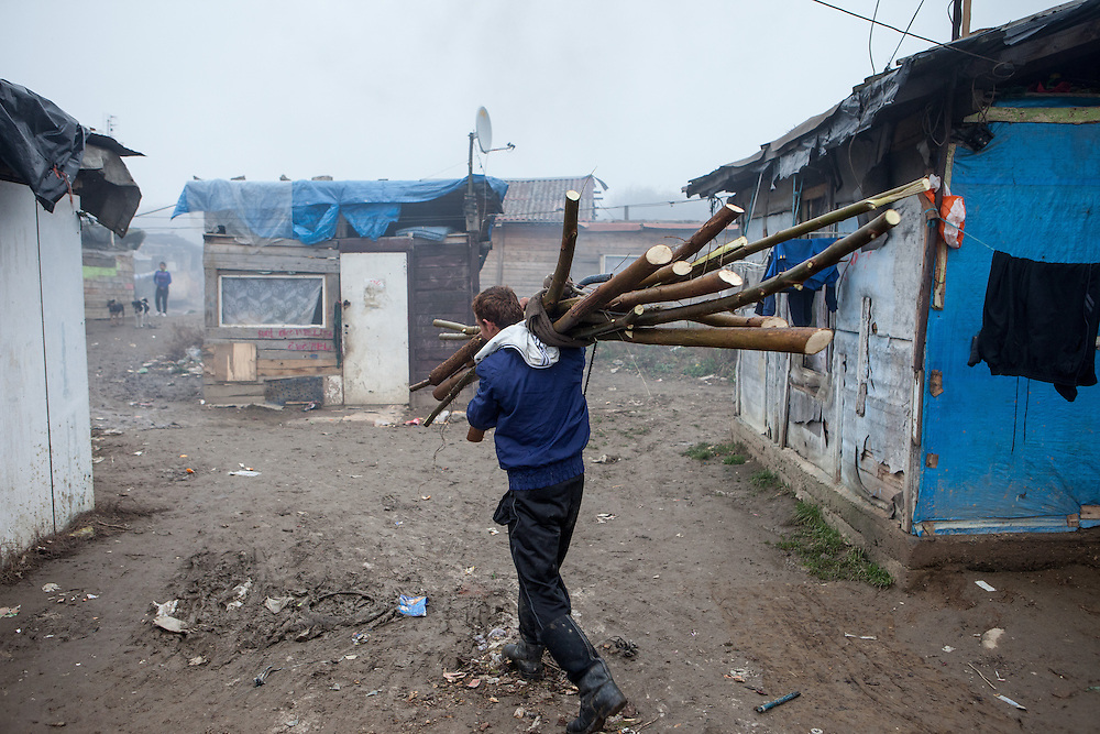 """Man after coming back from collecting wood from a close by forest for heating his house at the Roma settlement located in """"Budulovskej Street"""" in Moldava nad Bodvou, Eastern Slovakia about 30 km from Kosice."""