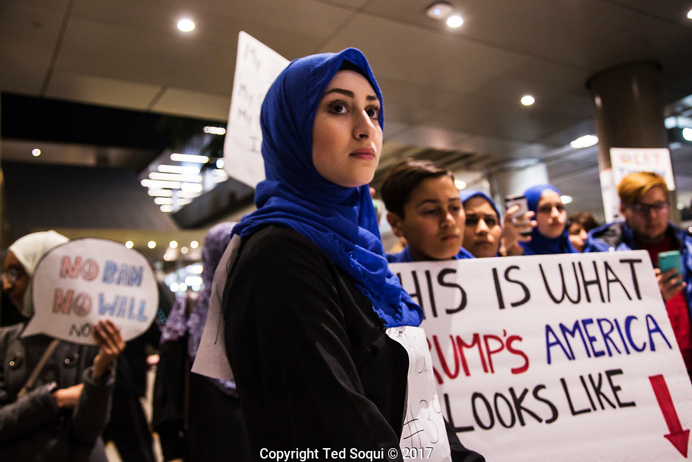 Immigrants from countries on the anti-travel Muslim ban return to the US at LAX airport.